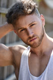 Handsome young bodybuilder  outside in vest Royalty Free Stock Photos