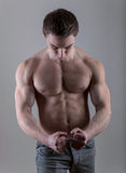 Handsome young bodybuilder posing Stock Photography