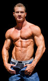 Handsome young bodybuilder shirless, isolated on black Royalty Free Stock Images