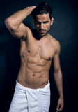 Handsome young bodybuilder showing of his fit body. And muscles Stock Photo