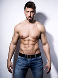 Handsome young bodybuilder showing of his fit body. And muscles Stock Photography