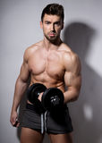 Handsome young bodybuilder showing of his fit body Royalty Free Stock Photography