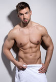 Handsome young bodybuilder showing of his fit body Royalty Free Stock Images