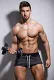 Handsome young bodybuilder showing of his fit body Stock Photo