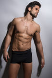 Handsome young bodybuilder showing of his fit body Royalty Free Stock Photos