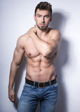 Handsome young bodybuilder with toned body Royalty Free Stock Image