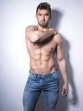 Handsome young bodybuilder with toned body Stock Photography