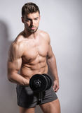 Handsome young bodybuilder with toned body Stock Image