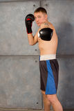 Handsome young boxer throwing a punch Stock Photo
