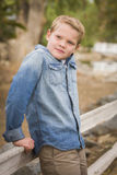 Handsome Young Boy Against Fence in Park Royalty Free Stock Images