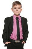 Handsome young boy in black suit Royalty Free Stock Photo