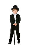 Handsome young boy in black tuxedo and tophat Royalty Free Stock Photos