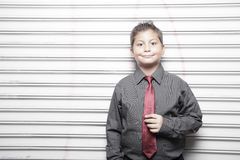Handsome young boy in business attire Stock Photo