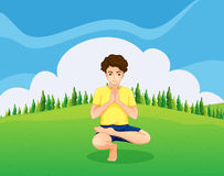 A handsome young boy doing yoga in the hill Royalty Free Stock Photography