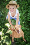 Handsome Young Boy and His Dog looking up. Outdoor portrait: Handsome Young Boy and His Dog looking up Royalty Free Stock Image