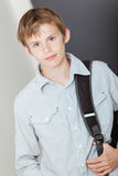 Handsome young boy with his school backpack Royalty Free Stock Photo