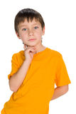 Handsome young boy imagines. A handsome young boy imagines on the white background stock photos