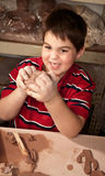 Handsome Young Boy In Clay Studio Stock Image