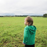 Handsome young boy looks at the field and dreams. Stock Image