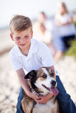 Handsome Young Boy Playing with His Dog Stock Photo