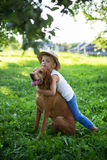 Handsome Young Boy Playing with His Dog at the park Royalty Free Stock Images