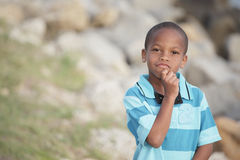 Handsome young boy pondering Royalty Free Stock Photography