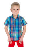 Handsome young boy in the red pants. A handsome boy in the red pants on the white background Royalty Free Stock Images