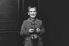 Handsome young boy with retro camera Stock Image