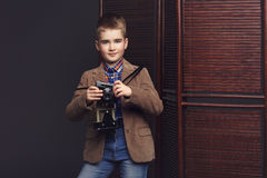 Handsome young boy with retro camera Royalty Free Stock Image