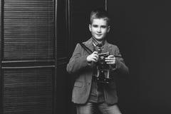 Handsome young boy with retro camera Stock Photos