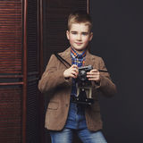Handsome young boy with retro camera Royalty Free Stock Photo
