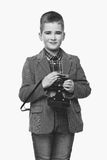 Handsome young boy with retro camera Stock Photography