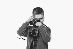 Handsome young boy with retro camera Royalty Free Stock Images