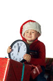 Handsome young boy in Santa's red hat holding a gift box Royalty Free Stock Photography