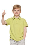 Handsome young boy shows his thumb up Stock Image