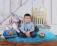 Handsome young boy sitting in Easter scene Stock Photo