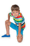 Handsome young boy in a striped shirt Royalty Free Stock Image