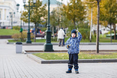 Handsome young boy walks in the area Royalty Free Stock Photo