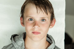 Handsome young boy with wet hair in a hoodie Stock Photography
