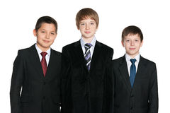 Handsome young boys in black suits Royalty Free Stock Photos