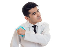 Handsome young brunette man doctor in white uniform with stethoscope take off a mask isolated in studio Stock Photography