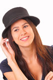 Handsome young brunette woman in a hat Stock Photos