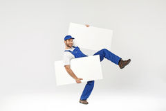 Handsome young builder holding empty boards Stock Photography