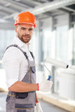 Handsome young builder is working in building Stock Photo