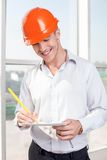 Handsome young builder is working on a new project Royalty Free Stock Photos