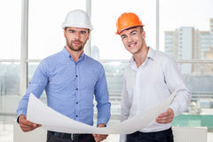 Handsome young builders are discussing a new Stock Photo