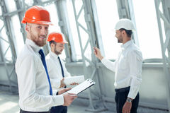 Handsome young builders are working on a new Royalty Free Stock Photography