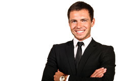 Handsome young business man. Portrait of a handsome young business man smiling royalty free stock image