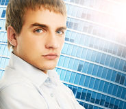 Handsome young business man. Over abstract background Stock Images
