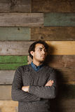 Handsome young business man against a wooden wall Royalty Free Stock Photography